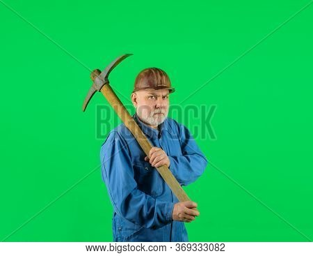 Bearded Man In Uniform Holds Pick Axe. Builder Man Holds Pickaxe. Craftsman Working With Pickaxe. Ma