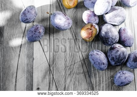 Plum And Dried Plum On A Wooden Black And White Background Top View Prunes