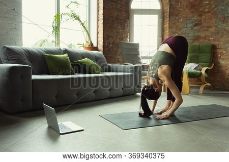 Strong. Sporty Beautiful Young Woman Taking Professional Yoga Lessons Online And Practice At Home. C