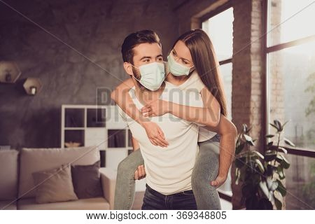 Photo Of Funny Young Couple Lady Guy Spend Quarantine Together Stay Home Hugging Piggyback Happy Emo