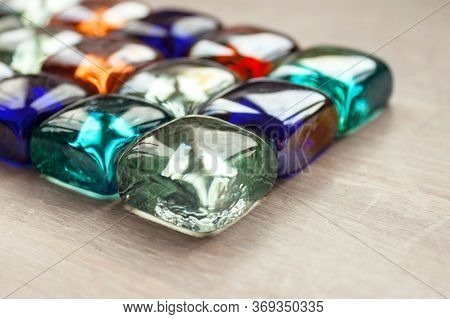 Abstract Background Of Multicolored Multicolored Glass Cubes, Crystals, Transparent Stones On Light