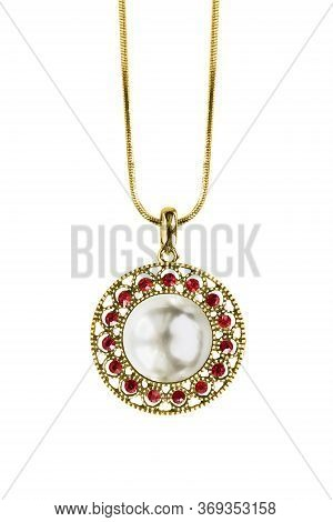 Vintage Beautiful Pearl Pendant With Red Gems Hanging On A Chain On White Background