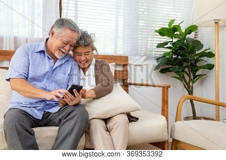 Asian Senior Couple Talking In Video Call Chat On Mobile Phone, Smart Technology For Old Age And Onl