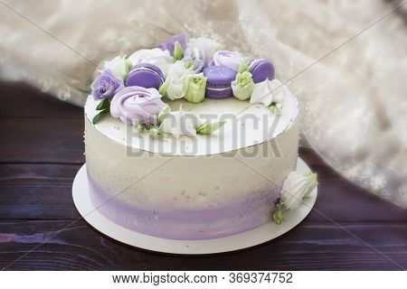 Beautiful Cakes. Cake With Flowers, Purple Macaroons And Meringues On Wooden Board. Wedding Cake, Bi