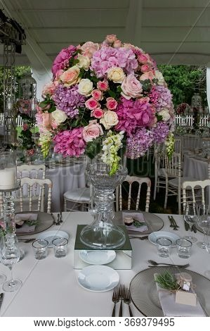 A Luxury Alfresco Wedding Reception Set Up At The Countryside; White Rustic Tiffany Chairs, Top Tabl
