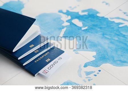 Immunity Passport, Risk-free Certificate Concept. Passports With Note Covid-19 Coronavirus With Red