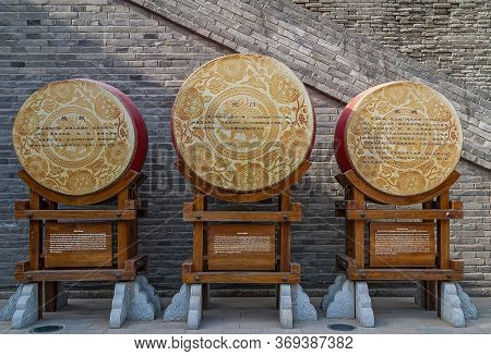 Xian, China - April 30, 2010: North Gate Of Huancheng City Wall. 3 War Drums On Display At Gate With
