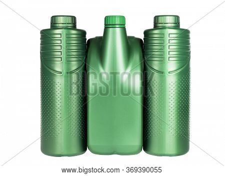 Row of Green Plastic Containers for Engine Lubricants on White Background