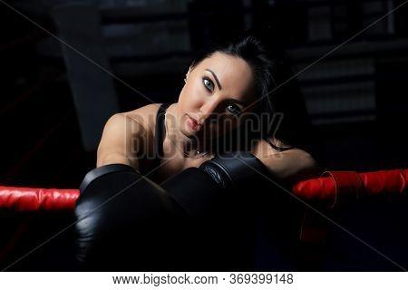 Beautiful Woman Boxer Portrait Over Dark Background, Girl Boxer On A Dark Background