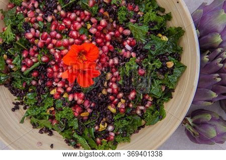 organic pomagranate and seed and kale salad