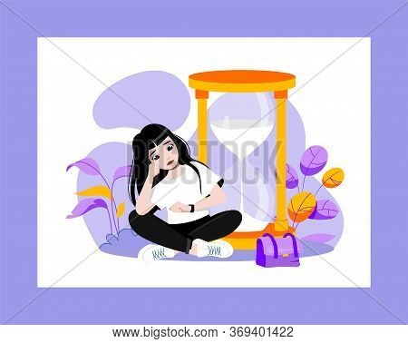 Waiting Concept. Young Attractive Sad Girl Is Waiting For Something Sitting Near Huge Hourglasses An