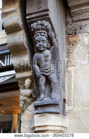 Bayeux, France - September 2, 2019: This Is A Carved Wooden Figure Adorning The Facade Of A Medieval