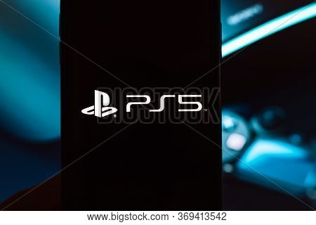 Smartphone With Sony Playstation 5 Logo On Screen. Ps5 Is The New 2020 Game Console. High Quality Ph