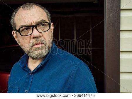 Alarmed incredulous man outdoors portrait