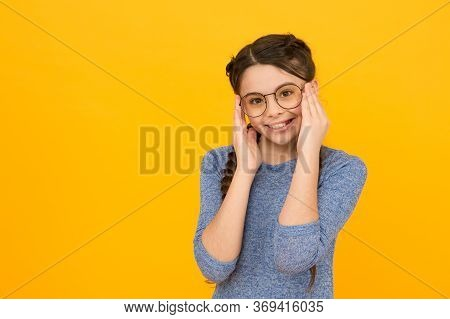 Cute Schoolgirl. Girl School Pupil Wear Eyeglasses Yellow Background. Adorable Nerd. Schoolgirl Conc