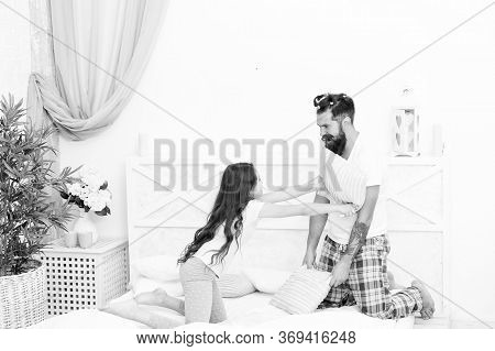 Playing Together. Small Child And Bearded Man Playing Pillow Fight. Happy Family Enjoy Playing In Be