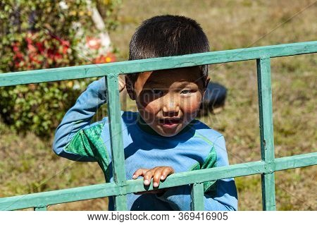 Ulan-bator, Mongolia - August 26, 2016: Mongolian Boy Greets Tourists At The Camp In Terelj National