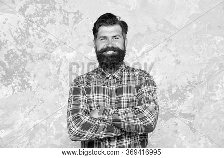 Grooming Service Concept. Well Groomed Macho. Handsome Hipster Man On Grey Wall Background. Bearded