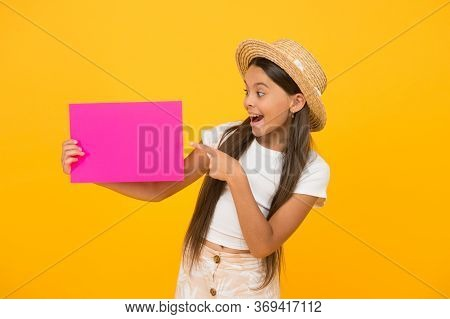 Paper Art And Craft Style. Look Here. Surprised Little Girl Pointing Finger On Paper Sheet. Place Fo