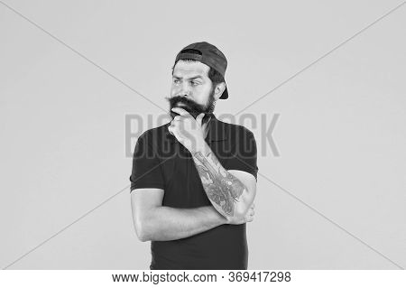 Hipster Life. Beard And Mustache Grooming. Cool Hipster With Beard Wear Stylish Cap. Barber Salon An