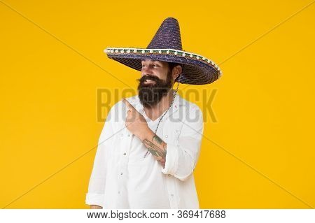 Customs And Culture. Guy Cheerful Festive Mood At Party. Man In Mexican Hat. Explore Heritage On You
