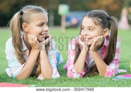Youre Awesome Just Like Me. Happy Children Relax On Green Grass. Beauty Look Of Small Children. Litt