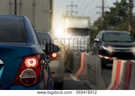 Luxury Rear Corner Of  Car On The Road.  With Open Brake Light. And Blurred Of Road Traffic Conditio