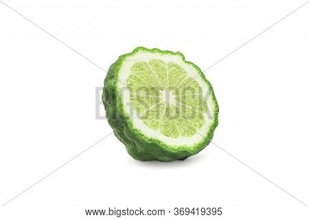 Cross Section Or Half Bergamot Or Kaffir Lime On White Isolated Background With Clipping Path. Berga