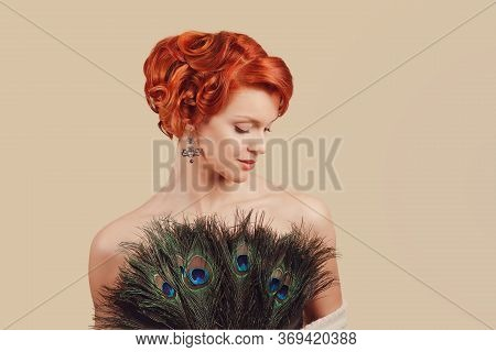 Girl With Peacock Feathers Dress. Closeup Red Head Beautiful Young Woman Happy Pinup Girl In Dress M