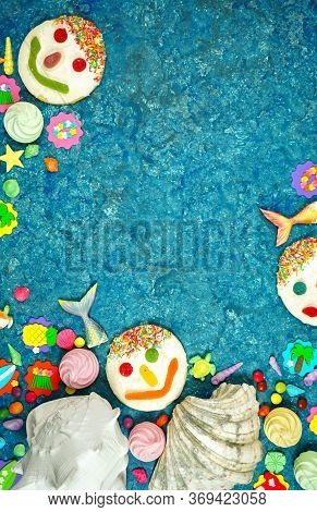 Beach Theme Flatlay With Shells, Fish Tails, Summer Party Icons And Cookies.