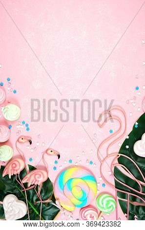Summer Theme Flatlay With Flamingos And Candy On A Pink Textured Background.