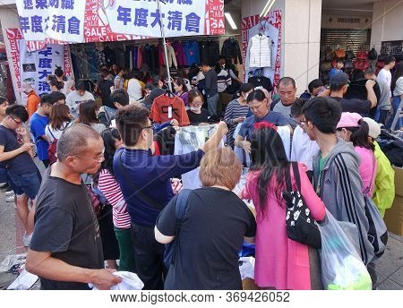 Kaohsiung, Taiwan -- February 6, 2019: People Snap Up Cheap Shirts And Clothing That Is For Sale At