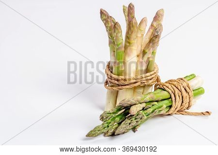 Green And White Fresh Asparagus On A White Background