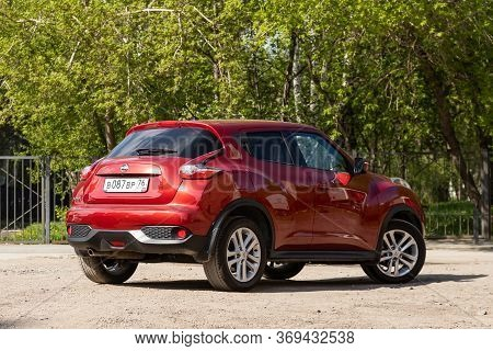 Novosibirsk/ Russia - May 15, 2020: Red Nissan Juke, Back View.  Modern  Crossover  Made In Japan On