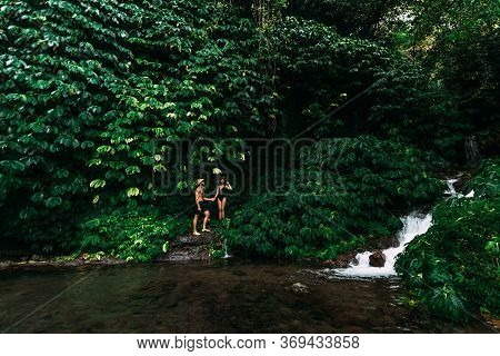 A Couple In Love At A Waterfall In Indonesia. A Couple In Love In The Tropics. Beautiful Couple Trav