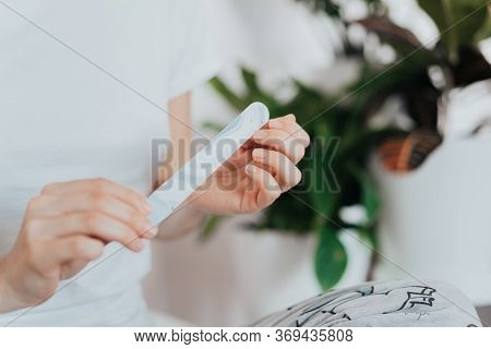 Close Up Girls Hands, Making A Manicure Herself And Using A Nail File At Home Because Of The Coronav