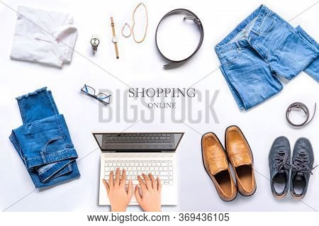Woman Working At Office Desk With A Laptop , She Is Shopping Online, Top View