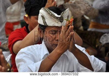 Bali, Indonesia - March 20, 2015 : Unidentified Man Is Praying In Balinese Temple During Nyepi Day O