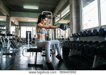 Sexy Sport Women Lifting Dumbbell Bicep Bodybuilding In Sport Gym