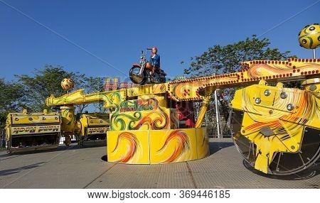Kaohsiung, Taiwan -- January 11, 2020: The Hard Rock Amusement Park Thrill Ride At A Local Fun Fair