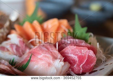 Selective Focus Of Mixed Slices Of Fresh Raw Salmon Sashimi For Dinner. Assorted Fresh Sashimi And J