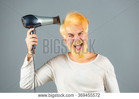 Dryer Blond Hair For A Bearded Hipster Guy. Blonde Man With Hairdryer, Dryer Or Fen