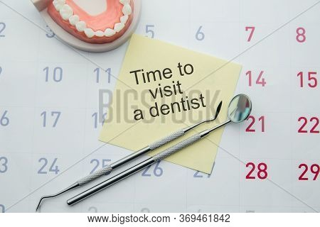 Dental Hygiene And Health Concept. Reminder Dentist Appointment In Calendar And Professional Dental