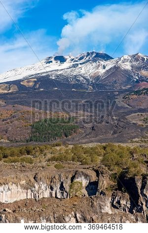 Mount Etna Volcano With Smoke And Snow In Winter. Catania, Sicily Island, Italy, Europe
