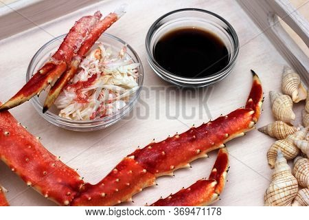 Crab Meat And Soy Sauce. Cooked Crab Legs. Seafood.