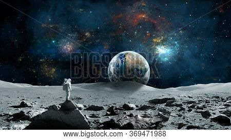 Space Background. Astronaut Standing On Moon Surface With Earth Planet And Colorful Nebula. Elements