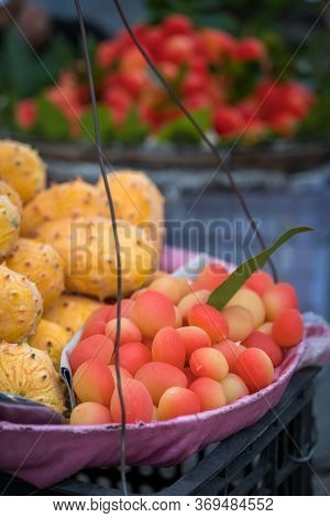 Colourful Tropical Fruits In A Carry Basket For Sale In China Street Market
