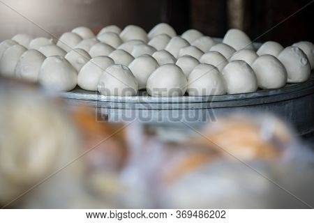 Delicious Traditional Chinese Baozi Buns Filled With Ground Pork Meat And Cabbage Ready To Be Steame