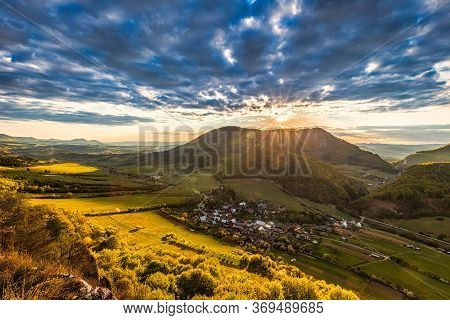 Mountainous Landscape At Sunset At Spring Time. View From The Top Of The Bosmany Rocky Hill Above Th