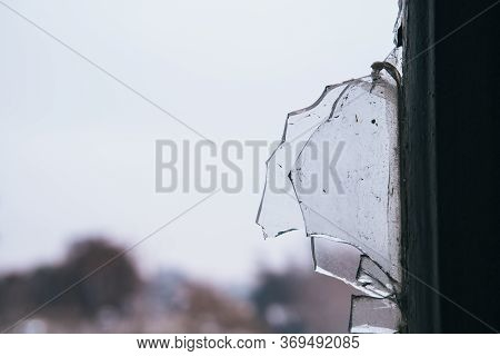 Close Up Of A Broken Glass Of A Window Of An Empty Abandoned Old Building